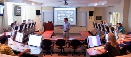Dr. John A. McArthur teaches in the Knight-Crane Convergence Laboratory in the James L. Knight School of Communication at Queens University of Charlotte