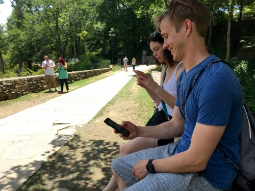 Jasmine and Ryan Smith play PokemonGo among scores of gamers in Falls Park.